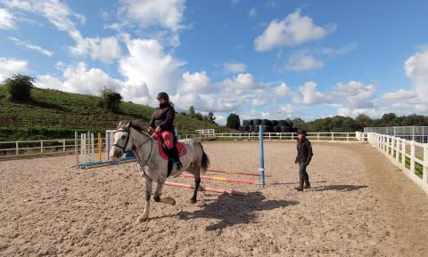 Horse riding in school with instructor