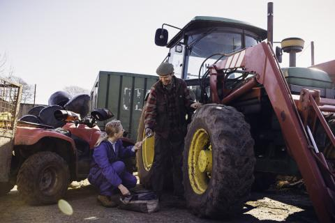 Land-based engineer working on a tractor