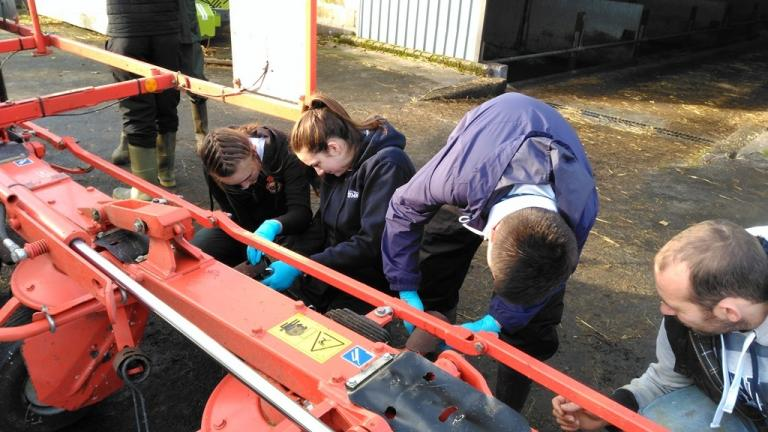 School pupils learning about farm equipment